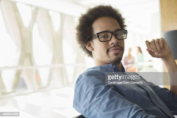 Portrait of confident casual businessman wearing eyeglasses