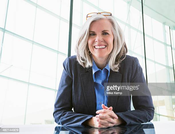 Portrait of confident Caucasian businesswoman at desk