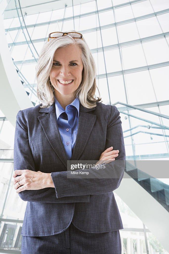 Portrait of confident Caucasian businesswoman : Stock Photo