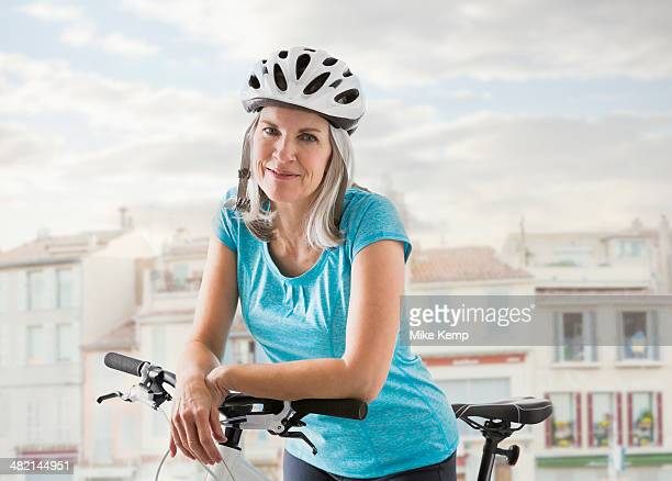 Portrait of confident Caucasian woman on bicycle