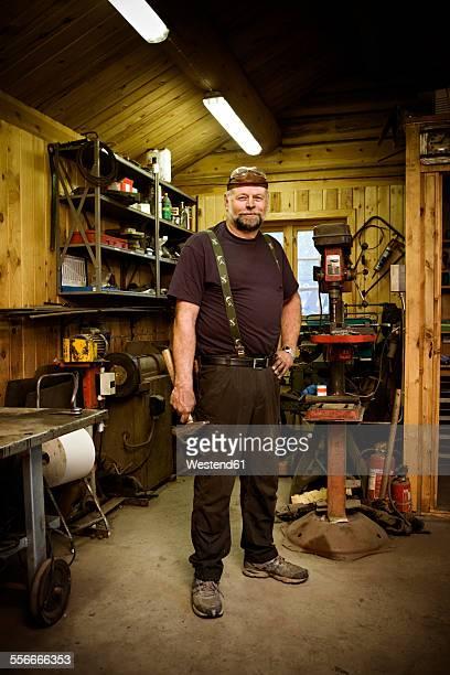 Portrait of confident craftsman in his workshop
