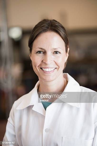 Portrait of confident engineer smiling in manufacturing industry