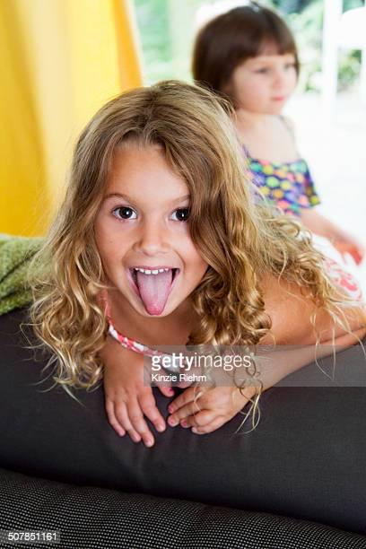 Portrait of confident girl sticking her tongue out