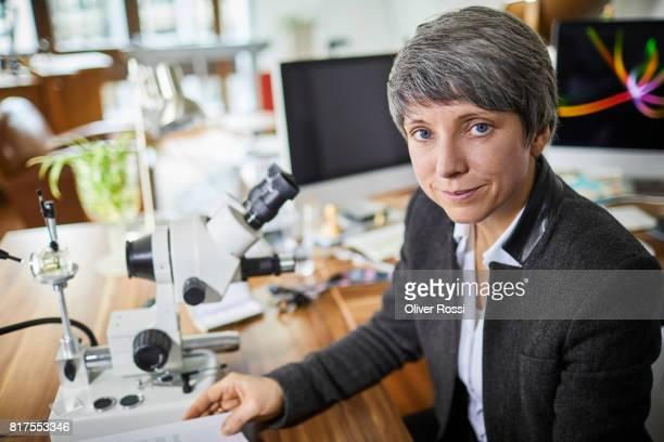 Portrait of confident goldsmith in her workshop