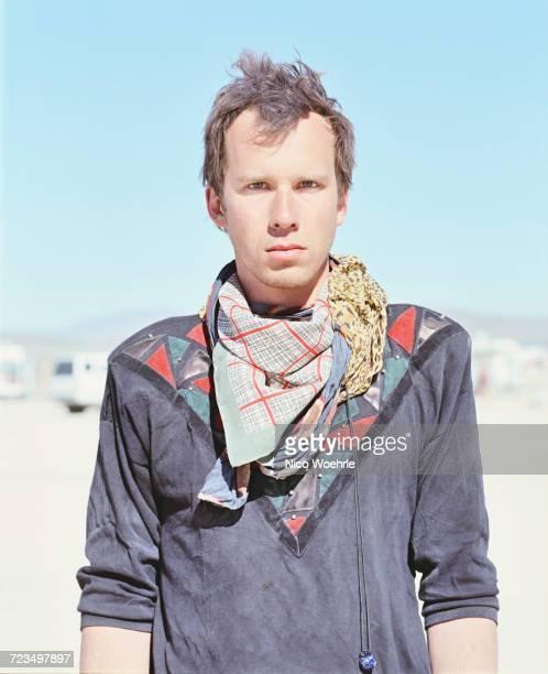 Portrait of confident man standing in desert on sunny day, Black Rock Desert, Nevada, USA