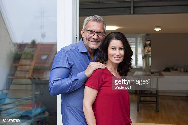 Portrait of confident mature couple at home