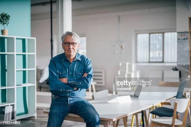 Portrait of confident senior businessman in office