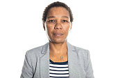 Portrait of confident senior businesswoman on white background. African female in business casuals looking at camera.