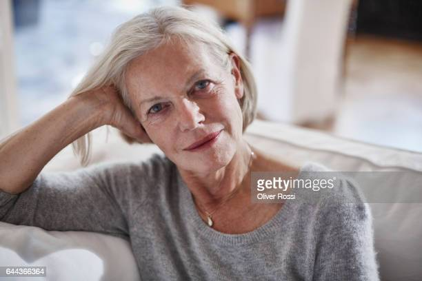 Portrait of confident senior woman at home