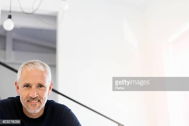 Portrait of confident smiling mature businessman
