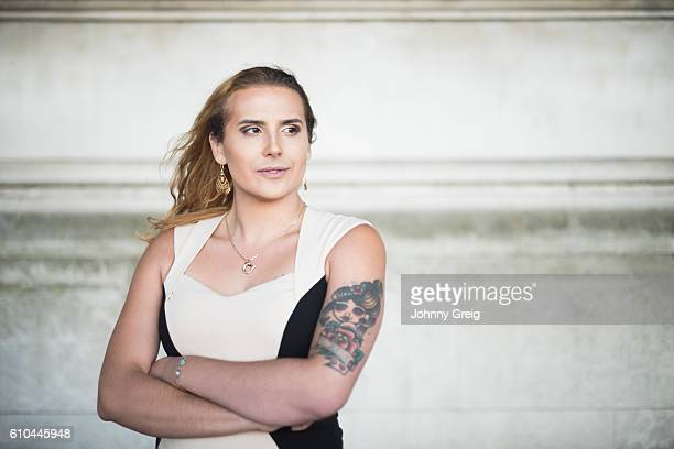 Portrait of confident transgender female with arms crossed