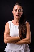 Studio Portrait Of Woman Against Black Background