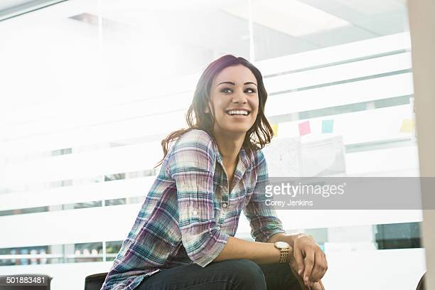 Portrait of confident young businesswoman in office