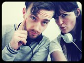 Portrait of confident young couple wearing headphones