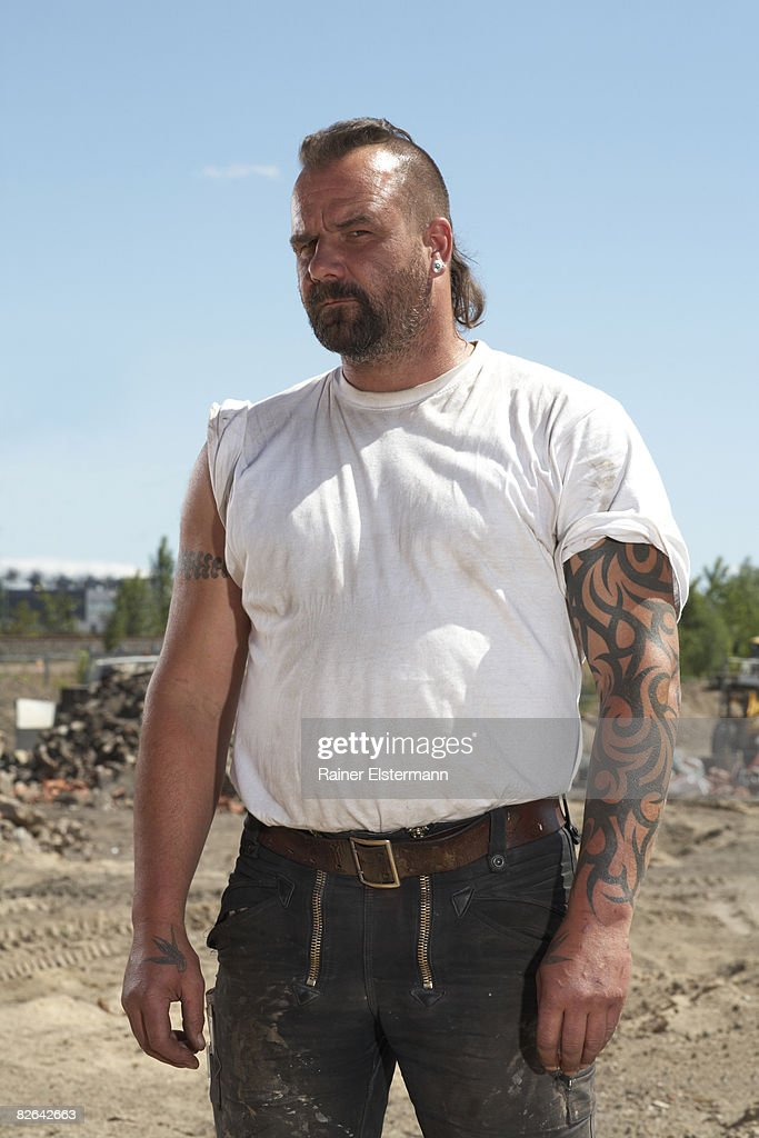 Portrait of construction worker on building site : Stock Photo