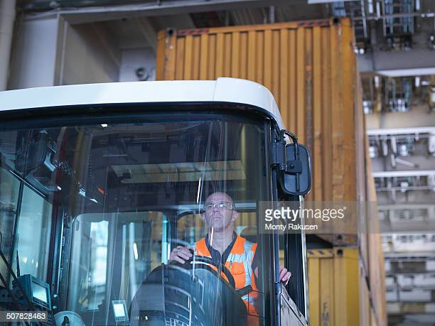 Portrait of container truck driver in ship's hold