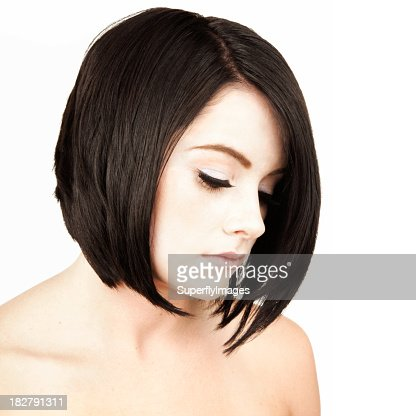 Portrait of Contemplative Young Woman with Short Dark Hair. Isolated.