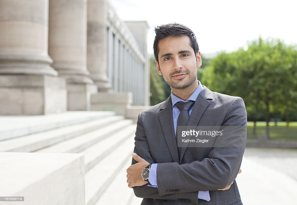 portrait of content businessman, head-on : Stock Photo