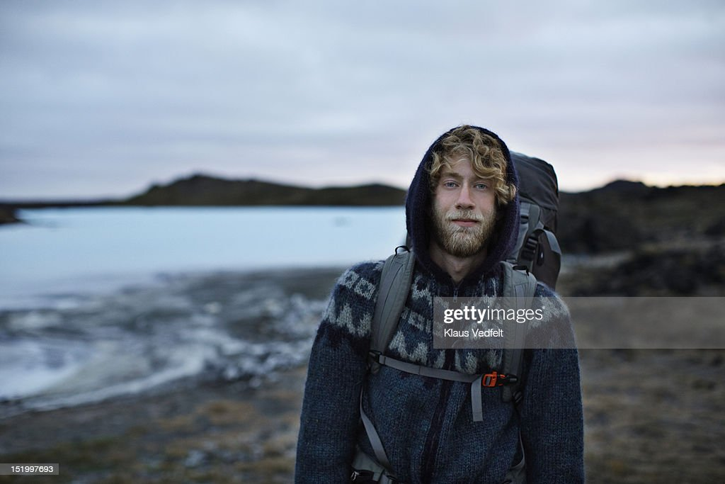 Portrait of cool backpacker smiling confident : Stock Photo