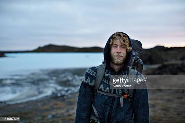 Portrait of cool backpacker smiling confident