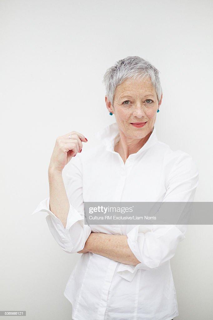 Portrait of cool confident senior female fashion designer