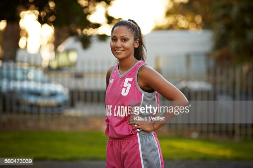 Portrait of cool female basket player