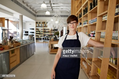 Portrait of cool female deli shop clerk