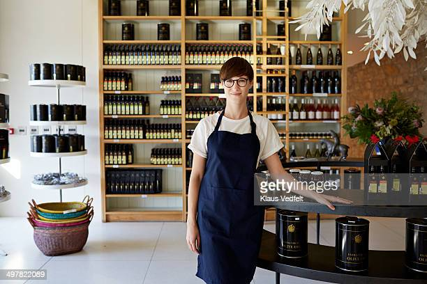 Portrait of cool female olive oil shop clerk