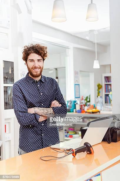 portrait of cool independent book shop owner