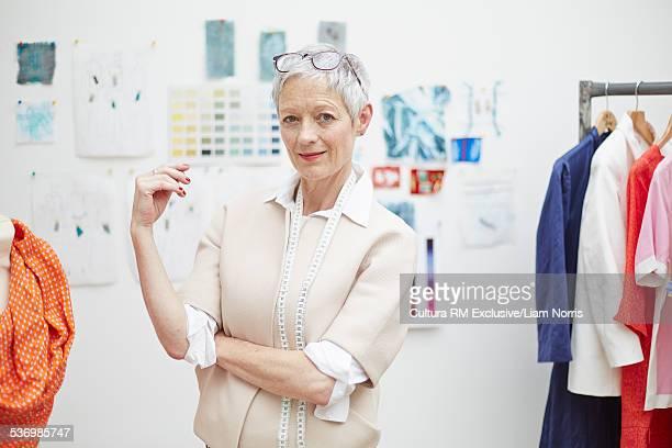 Portrait of cool senior female fashion designer