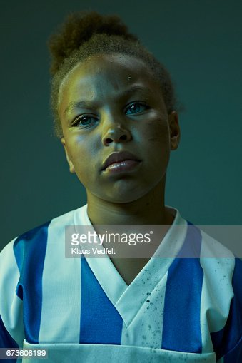 Portrait of cool young female football player