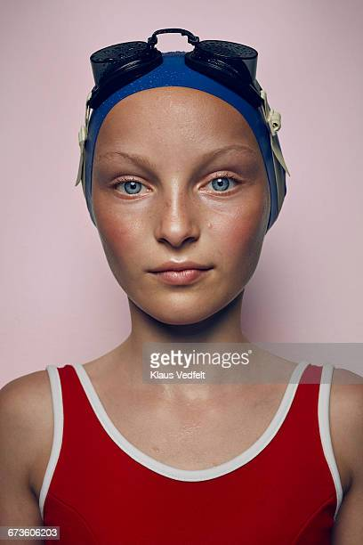 Portrait of cool young female swimmer