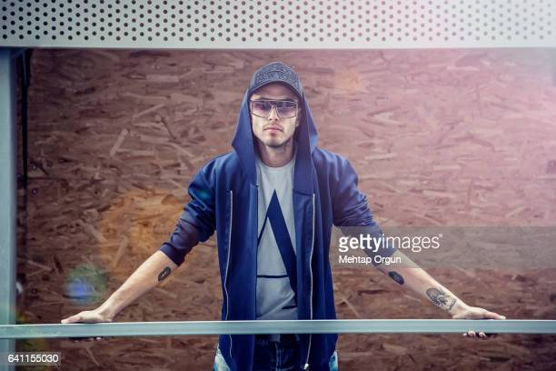 Portrait of cool young man, in urban street