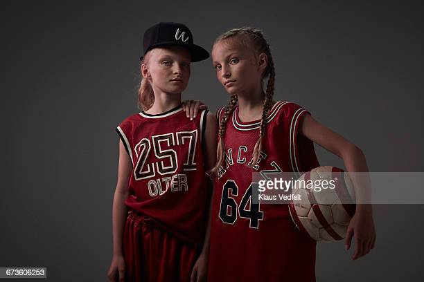 Portrait of cool young twin ball players