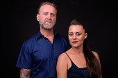 Studio Shot Of Couple Against Black Background