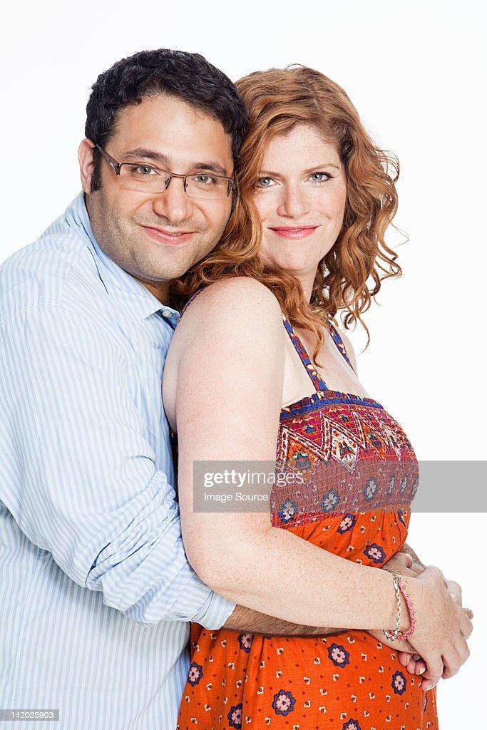 Portrait of couple against white background : Stock Photo