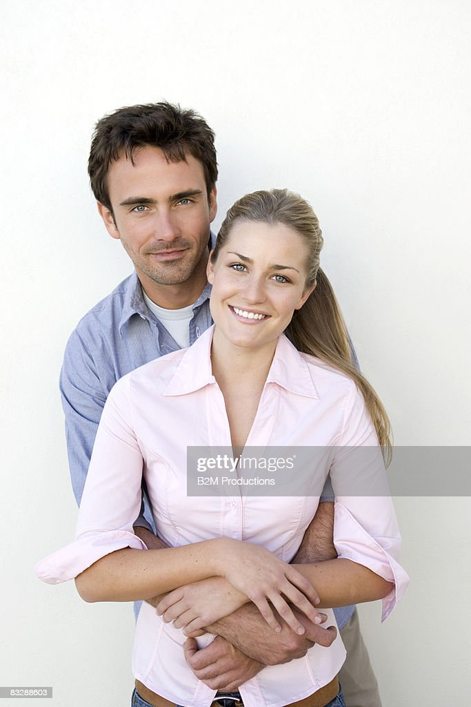 Portrait of couple hugging : Stock Photo