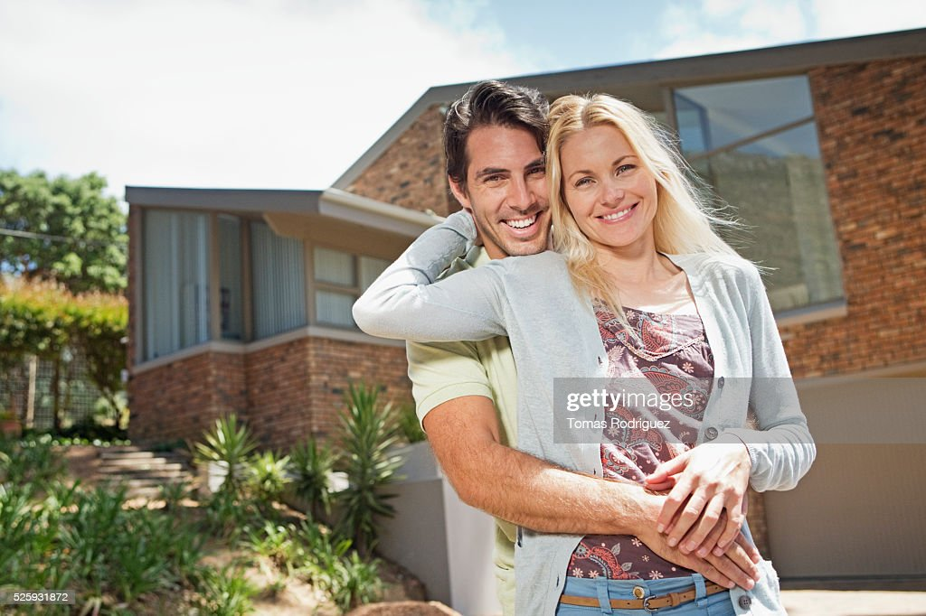 Portrait of couple in front of house : Stock-Foto