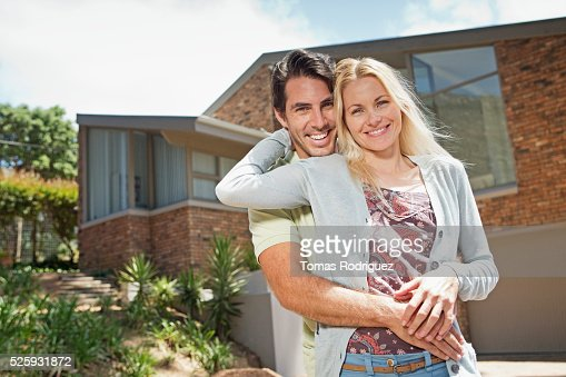 Portrait of couple in front of house : Stock Photo