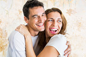 Portrait of couple laughing and embracing