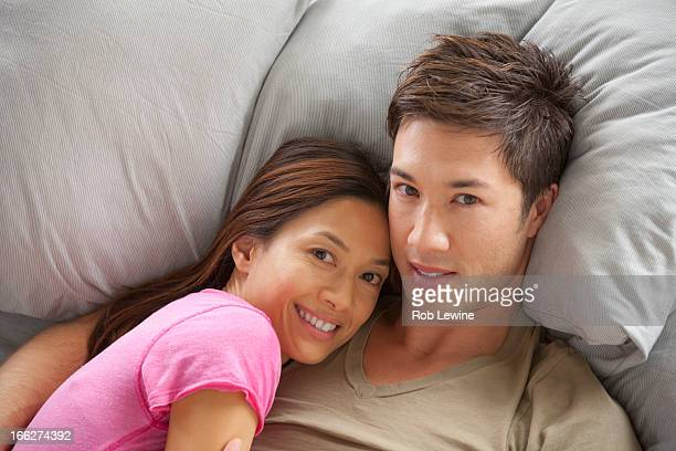 Portrait of couple lying in bed