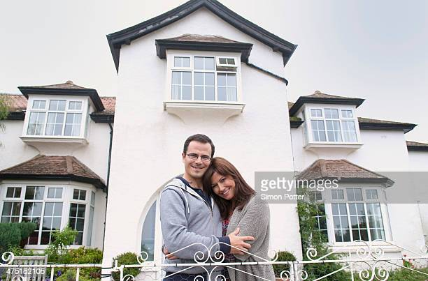 Portrait of couple outside house