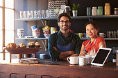 Portrait Of Couple Running Coffee Shop Behind Counter