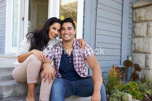 Portrait Of Couple Sitting On Steps Outside Home : Foto de stock