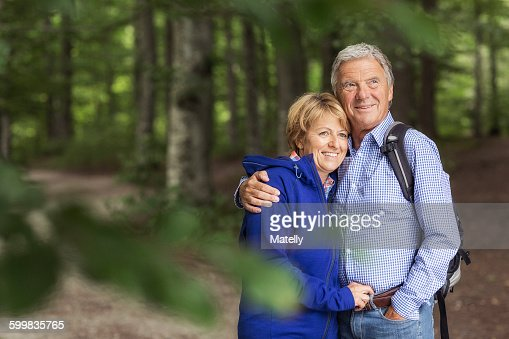 Portrait of couple standing in forest