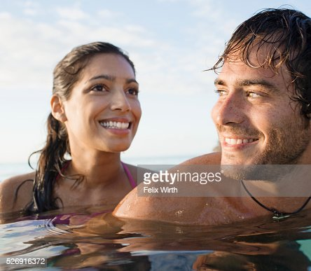 Portrait of couple swimming in sea : Stock-Foto