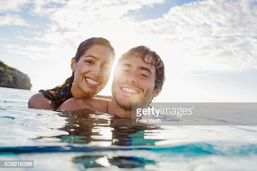 Portrait of couple swimming in sea : Photo