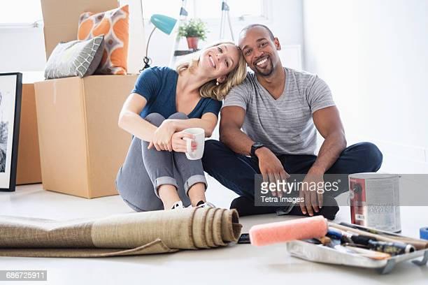 Portrait of couple taking break during apartment renovation