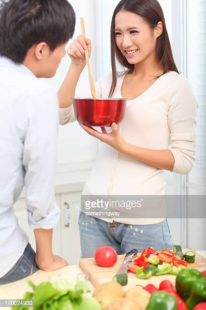 Portrait of couple tasting a meal