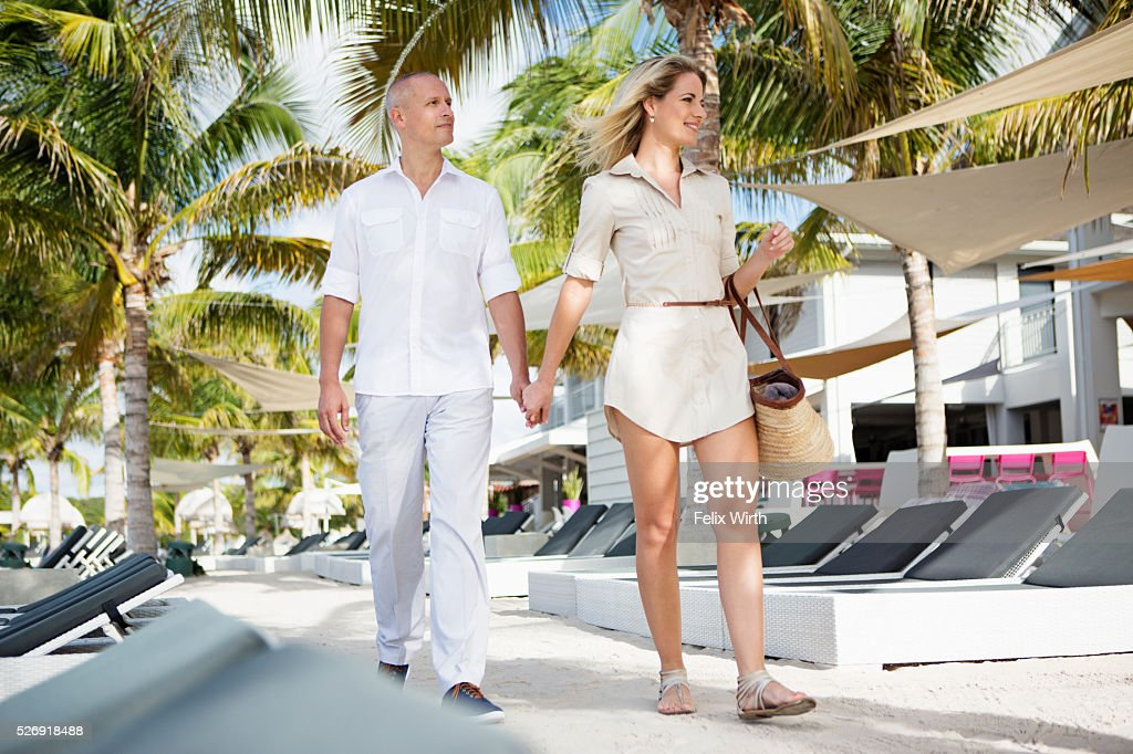 Portrait of couple walking in tourist resort : Stock Photo